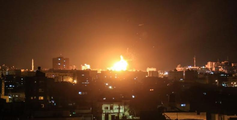 An explosion is seen in northern Gaza City after an airstrike carried out by an Israeli warplane on June 20, 2018.  Photo: AFP