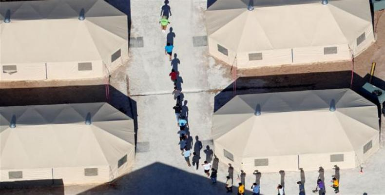 Migrants imprisoned in tent camp.  Photo: AP