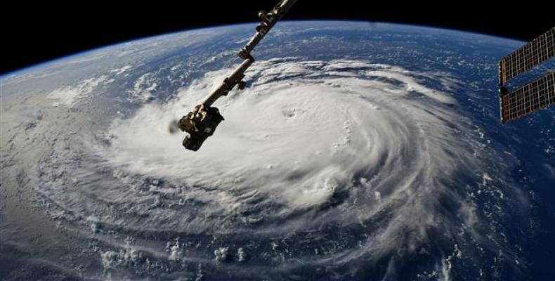 NASA handout photo shows a view from the International Space Station of Hurricane Florence off the US ٍٍٍEast Coast in the Atlantic Ocean, on September 10, 2018