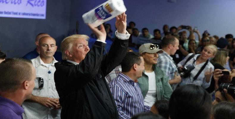 This is how US president Donald Trump provided assistance to victims of hurricane Maria in Puerto Rico. File Photo