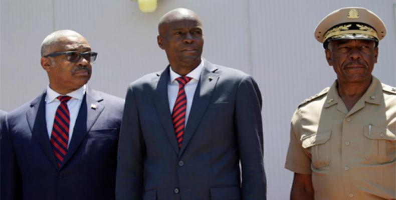 Haitian President Jovenel Moise (C), Prime Minister Jack Guy Lafontant and Chief of the army's high command Jodel Lessage