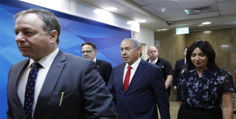 Israeli Prime Minister Benjamin Netanyahu, center, attends the weekly cabinet meeting at his office in Jerusalem al-Quds, July 8, 2018.   Photo: AFP