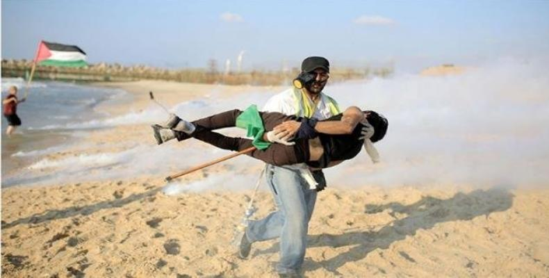 A Palestinian protester is injured in the northern part of the besieged Gaza Strip during a naval rally against the decade-long Israeli siege on the impoverish