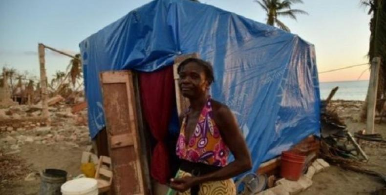 Woman in front of her makeshift house. Port-au-Prince, Haiti. April 2020. (Photo: Twitter/@MrNegroMilitant)
