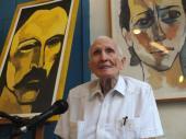 José Ramón Fernández, presidente del Comité Olímpico Cubano junto a obras del pintor de iberoamerica Oswaldo Guayasamin